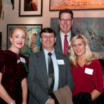 Landmark Society trustees, including new trustee Drew Costanza, pose for the camera.