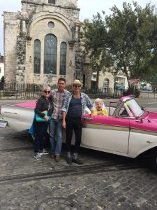 Landmark Society tour goers and Ramses, their Cuban vintage car driver, head out for a short driving tour before leaving Havana to return home.