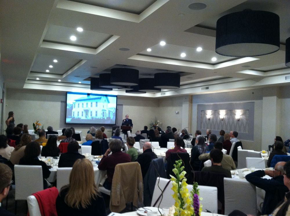 Saturday speaker, Ed McMahon of the Urban Land Institute, at the newly remodeled East Ave Inn & Suites.