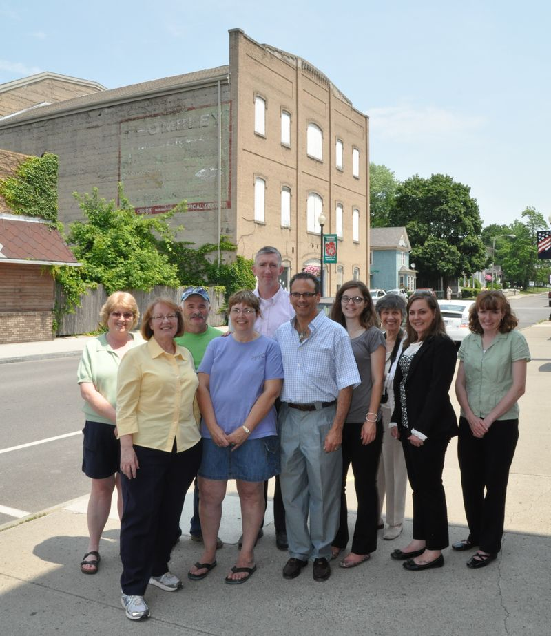 Local preservationists and Landmark Society staff in front of the Sampson Theater, a 2013 Five to Revive property.