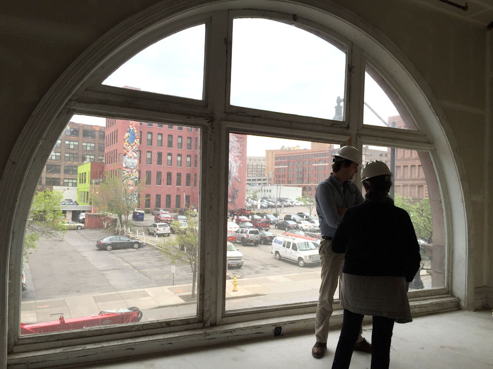 Wide arched windows to admit natural light onto the factory floor now provide residents unparalleled views day and night.